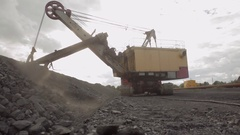 Excavator charging shovel with stones Stock Footage