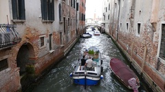 Venice slow motion of workboat in canal. Stock Footage