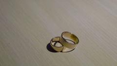 Wedding rings isolated on wood Stock Footage