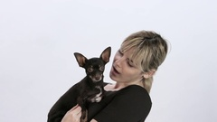 Young Blonde woman cuddles Chihuahua Stock Footage