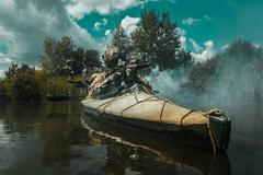 Spec ops in the military kayak Stock Photos