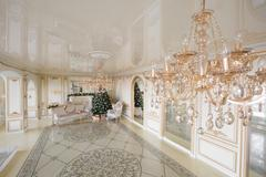Calm image of interior Classic New Year Tree decorated in a room with fireplace Stock Photos