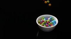 Colorful Candy Balls Spill And Bounce Into Bowl Stock Footage