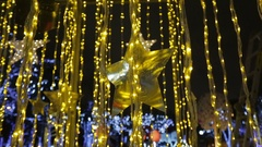 Star shape and golden rain lightning on a street decorated for Christmas Stock Footage