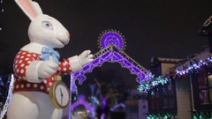 White Rabbit with pocket clock from Wonderland and decorated Gate Stock Footage
