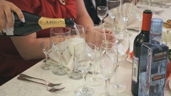 Waiter pouring the glass of sparkling wine indoors Stock Footage