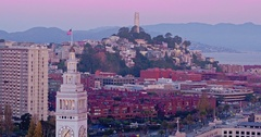 Aerial of coit tower, San Francisco Ferry Building & Embarcadero at sunrise Stock Footage