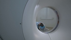 Patient in a Emergency hospital MRI scanner. Man lays in Magnetic Resonance Arkistovideo