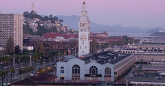 Aerial from Pier, San Francisco Ferry Building & Embarcadero at sunrise Stock Footage