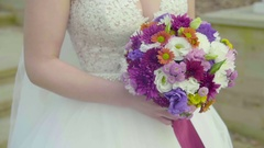 Closeup view of a Bride Holding a Bouquet Stock Footage