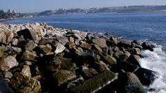 Slow Motion of Ocean Waves Crashing Over Rocks Stock Footage