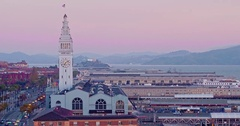 Aerial of San Francisco Ferry Building & Embarcadero at sunrise Stock Footage