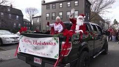 Reverse Shot Santa and Mrs Claus Christmas Parade Stock Footage