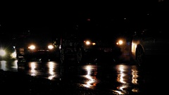 Cars Driving And Queuing On Rainy Night Stock Footage