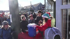 Teenagers Selling Hot Chocolate at a Christmas Parade Stock Footage
