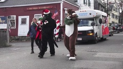 Mascots and Bus Christmas Parade Stock Footage