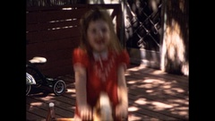 Little Girl on Rocking Horse early 1960's Stock Footage