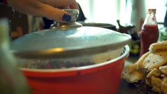 Delicious hot healthy diet food vegetable stew in a red pot Stock Footage