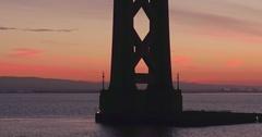 Aerial close up of of traffic on San Francisco Bay Bridge at sunrise Stock Footage