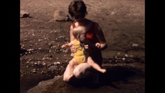 Mother and baby at beach Stock Footage