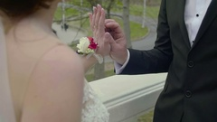 Closeup view of touching hands of newlyweds Stock Footage