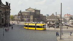 Yellow tram drives through Dresden, Semperoper Opera house, Germany Stock Footage