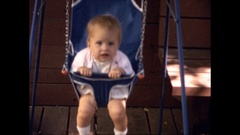 Baby in Swing early 1960's Stock Footage