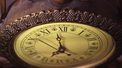 Antique old brass clock ticking slowly by V2 Stock Footage