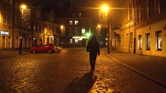 WARSAW, POLAND - NOVEMBER, 28, 2016. Cozy old town street at night. European Stock Footage