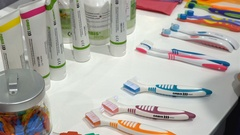 Samples of toothbrushes and toothpastes on the stand. Stock Footage