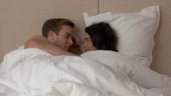 Woman and man in bed. Stock Footage