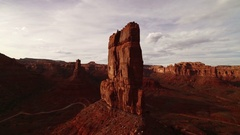 Rock Formation in Desert Canyon Aerial Shot at Sunset in Valley Stock Footage