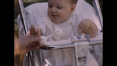 Infant baby girl chewing Stock Footage