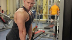 Powerful man during workout. Bodybuilder working out biceps in the gym. Stock Footage