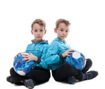 Image of amusing twin brothers posing with balls Stock Photos