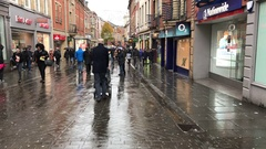 People shopping in the rain. Clumber Street. Nottingham, England. Stock Footage