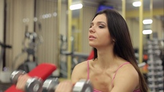 Young sexy girl is engaged with dumbbells in gym. Sport. Fitness. Bodybuilding. Stock Footage