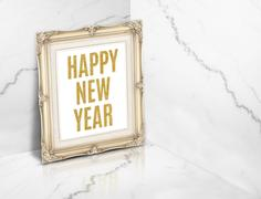 Happy new year word on vintage golden photo frame at white glossy marble co.. Stock Photos