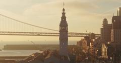 Aerial of San Francisco Ferry Building, bay bridge, Embarcadero & city at Stock Footage