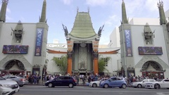 Chinese Theater on Hollywood Boulevard Walk of Fame with people and tourists Stock Footage