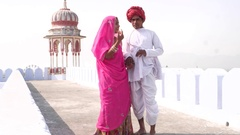 Beautiful bride and groom dating leisurely on a rooftop in Pushkar, Rajasthan, I Stock Footage