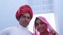 Close up of a newly fresh married Indian couple in ethnic attire posing for phot Stock Footage