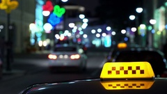 Illuminated Sign of Taxi Cab Blurred Stock Footage