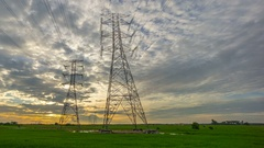 Sunset Over Transmission Electric Tower Pylon Stock Footage