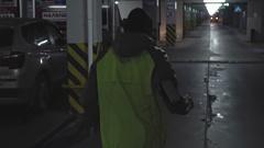 Sporty Man Running through Parking Lot Stock Footage