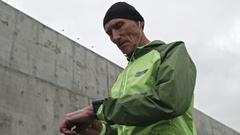 Senior Man Timing his Run Stock Footage