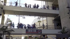 People walking on bridge in Hollywood and Highland Mallin Los Angeles  Stock Footage