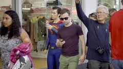 Superman actor in costume walking among tourists, people in Hollywood LA Arkistovideo