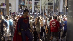 Superman actor emerging from crowd on Hollywood Boulevard Walk of Fame Arkistovideo