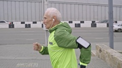 Senior Man Running and Stair-Climbing  Stock Footage